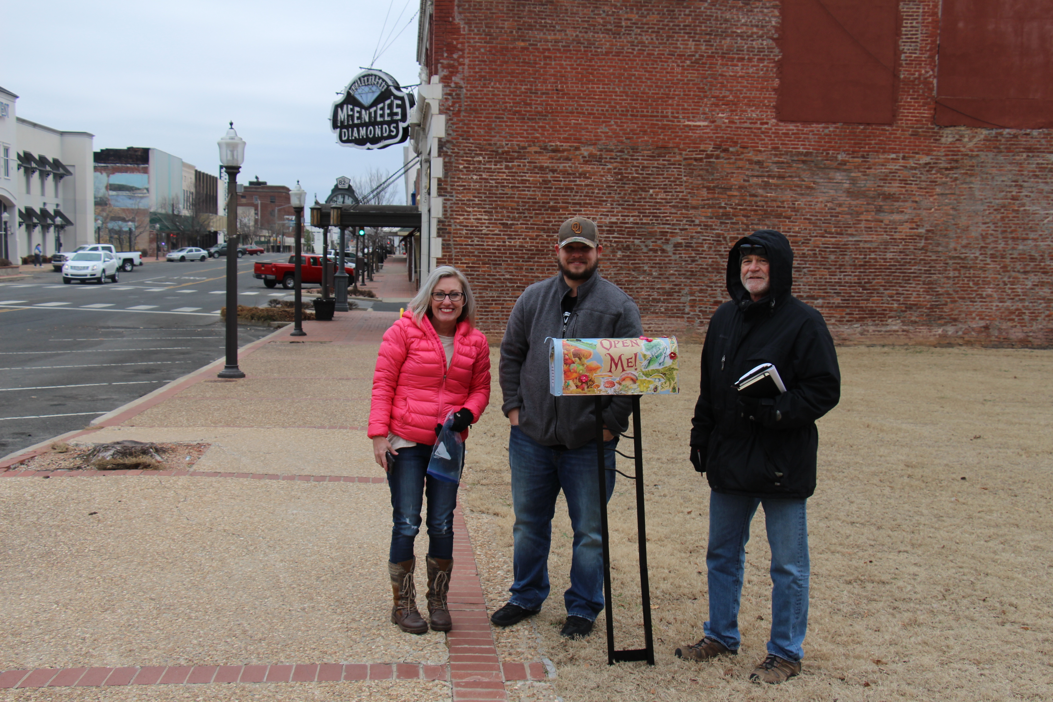 Robi, Kyle, and Greg standing by the artsy idea box for the Muskogee Green.
